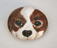 Cavalier Rock Art By Cori Solomon    A Rock Art keepsake of a dog. This acrylic rock art depicts the facial expression of a cute Cavalier King Charles