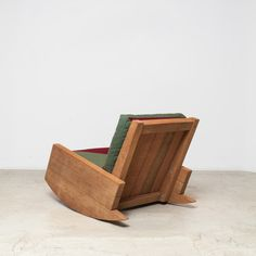 """""""Asturias"""" armchair in its rocking version is a bold option with a sophisticated, rustic look. Motta designed this line of furniture using reclaimed and demolition wood, plentiful in urban centers like São Paulo. Available with upholstered cushions. Suitable for both indoors and outdoors."""