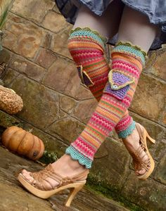 Cute legwarmers! Looks like the length is knitted and the top and bottom edging are crocheted.