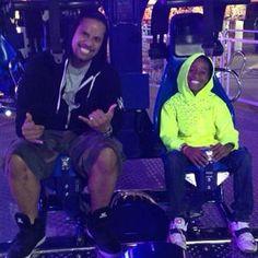 WWE Superstar Jimmy Uso (Jonathan Fatu) and his son Jaden at an amusement park