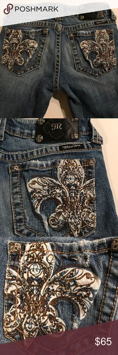 """🔥INCREDIBLE MISS ME JEANS🔥 🔥INCREDIBLE MISS ME JEANS🔥. Fantastic pair of jeans. Size 27. Distressed. Boot cut. Original hem. Beautiful Fleur de lis design on back pockets brow and bronze partly threads and stones.  Perfect condition. Measures 40 1/2"""" long from waist to bottoms. 14"""" across waist. 32 1/2"""" inseam. Miss Me Jeans Boot Cut"""