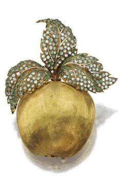 18 karat gold and green beryl apple brooch, Buccellati - The apple of satin-finished gold crowned by three leaves studded with circular green beryls, gross weight approximately 36 dwts., signed Buccellati.   © 2015 Sotheby's