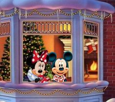 Mickey and Minne at the window with the Christmas tree in the back with the fire place on....SWEET
