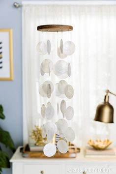 Sophisticated and stylish, this capiz shell wind chime will add a subtle, calming tune to your porch or patio.