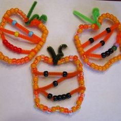 We made these easy beaded pumpkin Jack O' Lantern ornaments to add to our Halloween decorations. Pin It My children love to bead and it is great fine motor skill practice. Materials orange and black beads chenille stems (2 orange, 1 green) fishing wire Directions 1. First, I put them to work...