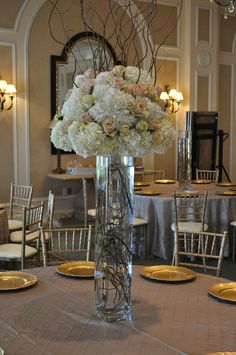 Tall Vase with Hydrangea and Roses. Love this and we never do the willow in the bottom, but will start -- different dimension.