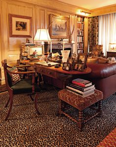 The Residence of Joan Rivers ; on Manhattan's Upper East Side's New York, a stunning expression of Rivers's taste in tones of ivory, gold, rose, and sky blue - sexy leopard skin-style carpet flooring for the private office space / library.