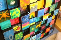 Another great children's auction art project idea - 3D wooden blocks. Cut blocks of different heights, have kids paint or decorate, set as collage, frame. Courtesy Olive and Love.
