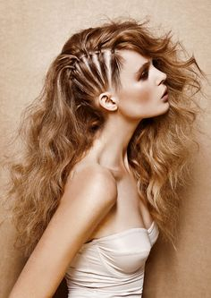 """Long hair side row pinned """"faux half shaved"""" effect loose waves."""