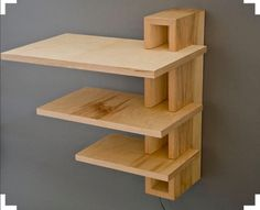 Small, wall hanging shelving unit with a Frank Lloyd Wright look about it