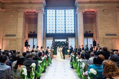 San Francisco's Asian Art Museum was all dolled up with taupe drapery, gold flatware, and dusty-pink uplighting to match the bridesmaids.