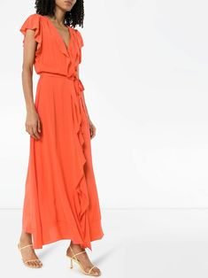 Melissa Odabash's wrap dress is what summer dressing is all about. Perfect for most occasions you can think of, the breezy wrap silhouette really lets your skin breathe. No sweat patches here. Featuring a deep V neck, a ruffled design and a belted waist.