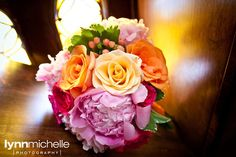 pastel old world themed wedding, beautiful pink and orange floral arrangement.