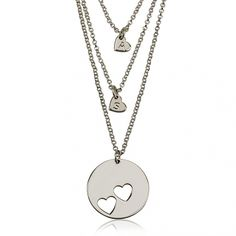 Show the world your heart with this gorgeously delicate sterling silver cut out heart and engraved initial necklace set.