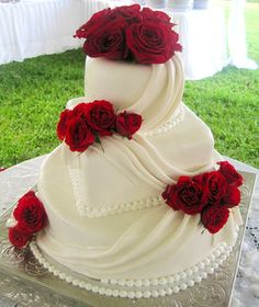 Wedding Cakes: Square angled wedding cake with deep red roses