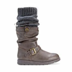 The flattering MUK LUKS' dark brown Sky boot is the perfect anywhere, anytime pull on style to complete your wardrobe. No heel. Available in sizes 6, 7, 8, 9, 10 with easy care instructions. No bleach