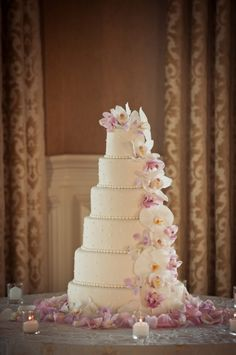 This is really pretty.  I love the beading and the orchids cascading down.