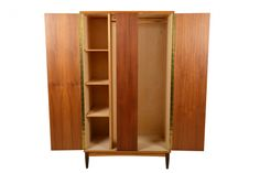 This Danish modern mid century teak armoire is a rare find.