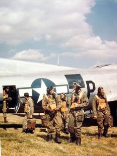 Crew members of an 8th Air Force B-17 just returning from a mission.