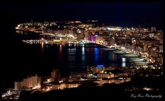 Fuengirola on the Costa del Sol at night. The area of Fuengirola's seafront is perhaps the most popular, the area opposite the port is packed with bars, pubs, cafes and discos where we'll be able to have a drink or dance till the morning light.