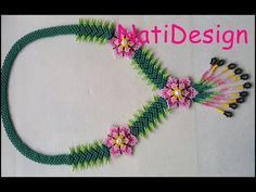 A beaded necklace. Wire Jewelry Making, Seed Bead Jewelry, Bead Jewellery, Beaded Jewelry, Pearl Jewelry, Tutorial Colar, Necklace Tutorial, Ring Tutorial, Seed Bead Tutorials