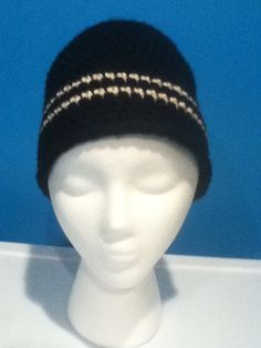 Crochet chunky yarn hat. Black with white stripes.