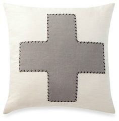 grey and white cross pillow