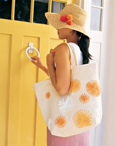Raffia Tote Bag and Straw Hat-A plain canvas tote and a straw beach hat are turned into bright, sunny creations using touches of raffia.    How to Make the Raffia Tote Bag and Straw Hat