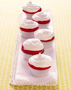 Red velvet cupcakes...have to make these every V-Day.  I haven't tried this recipe...I wonder if the frosting is as good as cream cheese frosting.