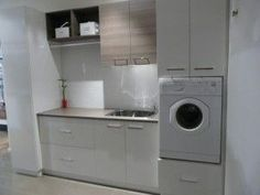 I want storage for my laundry hampers, my brooms, vacuum & cleaning supplies and my laundry supplies as well as hiding my washing machine & dryer. Laundry Cupboard, Laundry Storage, Laundry Hamper, Utility Cupboard, Hidden Laundry, White Laundry Rooms, Laundry Room Doors, Laundry In Bathroom, European Laundry