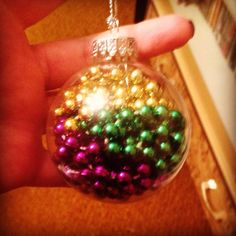 I filled an empty Christmas bauble with my New Orleans Mardi Gras beads.
