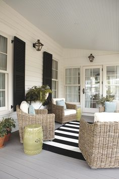 southern living idea house porch : simple with stripes, black shutters, light blue ceiling, wicker furniture Black Shutters, Southern Living Homes, Wicker Chairs, Outdoor Wicker Furniture, Patio Chairs, Chair Cushions, House With Porch, Striped Rug, Outdoor Rooms