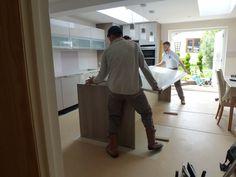 Installation of island work top - Colella Interiors kitchen installation process
