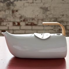 unusual teapot design - a wonderful mixture of porcelain, wood and steel.