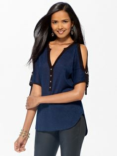 Dolman slit sleeve sweater with lace back yoke. Button henley front. Longer back hem. Tie sleeve detail with tab.Knit: 77% rayon, 17% polyester, 6% metallicLace: 55% rayon, 29% cotton, 16% nylonImportHand wash