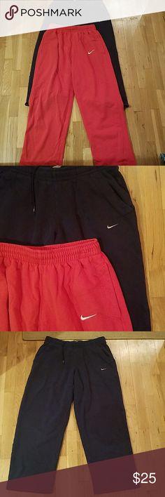 BUNDLE MENS NIKE SWEATPANTS!! 2 pairs of mens nike sweatpants. Size medium. Red pants are full length. Navy pants hit at calf. See pics, great condition!! Nike Pants Sweatpants & Joggers