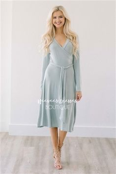 This lovely dress will be your new spring favorite! Comfortable, beautiful and perfect for nursing mothers too! Light sage dress features a cross over front, long sleeves and waist tie sash. Unlined.
