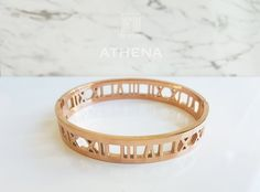 Steal the spotlight with this bold & beautiful Roman Empress bangle. Two sleek rose gold bands connected with classic Roman numerals. This piece adds a touch of luxury to any casual or formal outfit. Sleek Rose Gold, Bangles, Bracelets, Gold Bands, Luxury, Rings, Jewelry, Jewlery, Jewerly