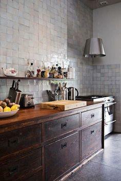Tile walls and dark wood. Like the random change in tile color, open shelf, etc.