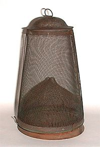Old Fly Traps - Screen. Cone-shaped fly trap with a wooden base.