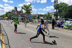 Kids playing street soccer in Uptown on Lake Street during Open Streets Minneapolis. Photo by LocalMN. #localmn #futbol #openstreets #lakestreet