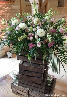 A stunning crate stack design by top Bristol wedding florists, The Wilde Bunch at Kingscote Barn. Barn Wedding Flowers, Kingscote Barn, Florists, Bristol, Crate, Countryside, Floral Wreath, Wreaths, Top