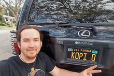 "Labour of love: Bukkhalter showing off his ""Kopi O' licence plate on his car in California."