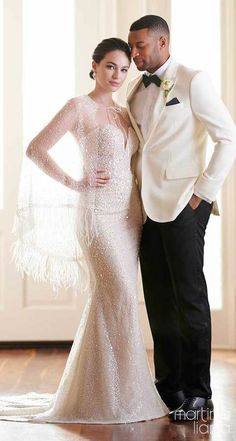 Strapless mermaid wedding dress with bling fabric and sweetheart neckline for the sparkly glamorous bride paired with illusion cape and feathers | Bride and groom romantic photo| Martina Liana Fall 2020 Wedding Dresses - Style 1299 - Belle The Magazine #weddingdress #weddingdresses #bridalgown #bridal #bridalgowns #weddinggown #bridetobe #weddings #bride #dreamdress #bridalcollection #bridaldress #dress See more gorgeous bridal gowns by clicking on the photo
