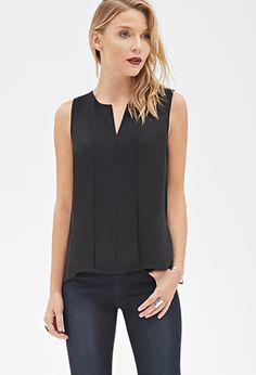 This sleeveless blouse is a workweek dream. It's crafted from an airy chiffon and features a layered front. Sophisticated little details like vented sides and a V-neckline keep this piece interesting enough for the office or off-duty.