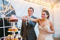 Beautiful bride Mary Claire & her handsome groom Casey cut the wedding cupcake: a perfect pair. Congratulations again, you two! | Photo credit: Dana Cubbage Weddings, wedding cupcakes: Cupcake DownSouth #weddingcupcakes