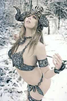 seriously what the hell is going on here? you are in the snow woman, put a coat on! nice horns though.