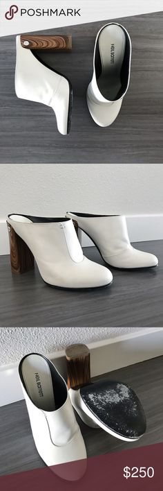 White wooden heel mules These white wooden block-heel miles by Neil Barrett, who has worked with Gucci, Prada and others, are so luxurious! They fit true to size and are pre-loved but in excellent condition. Originally purchased at Intermix. Neil Barrett Shoes Mules & Clogs