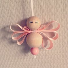 DIY Christmas angel. Wooden balls, ribbon and a pen.