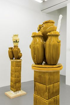 "Fragile Monuments to the Jar's Ancient Form | Hyperallergic | Foreground: Nicole Cherubini ""Goldenrod"" (2015), earthenware, glaze, medium-density fiberboard (MDF), magic sculpt, 67 x 19 x 22 inches; background: Nicole Cherubini ""Althean"" (2015), earthenware, glaze, medium-density fiberboard (MDF), magic sculpt, 5 min epoxy, 75 x 19 x 22 inches (all images courtesy Samsøñ)"